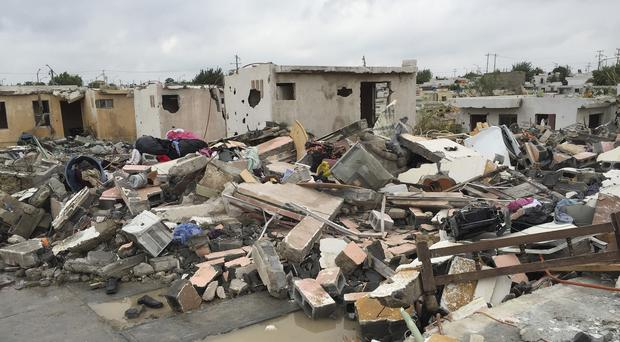 The tornado raged through the city on Monday, destroying homes. (AP)