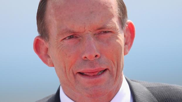 Prime minister Tony Abbott said Australia plans to pass a law within weeks to give the government the power to strip citizenship from dual nationals who are suspected terrorists even if they are not convicted of a crime