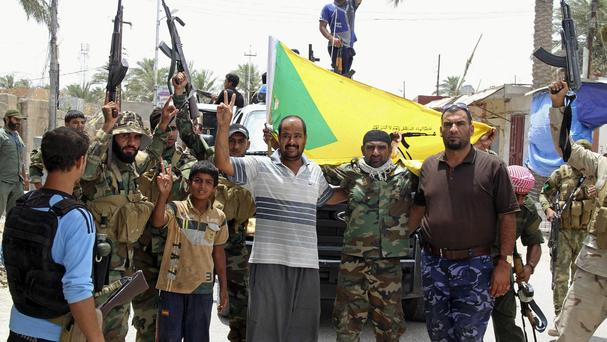 Residents and Sunni fighters welcome Iraqi Shiite Hezbollah Brigade militiamen, who are joining the fight against Islamic State (AP)