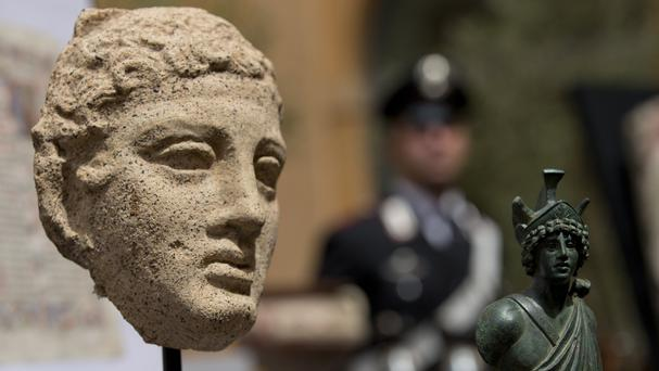 Artefacts are shown during a press conference in Rome (AP)