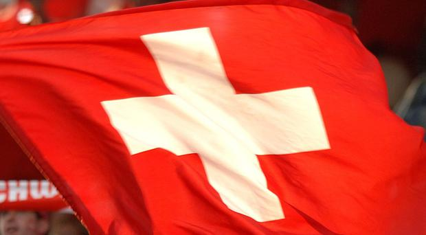 The Swiss Federal Office of Justice says US authorities suspect the officials of receiving or paying bribes totalling millions of dollars