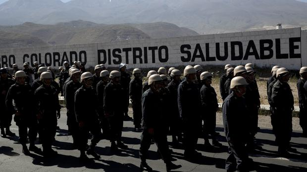 Police wearing helmets loaned to them by the army at an anti-mining protest in Arequipa (AP)