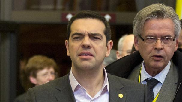 Alexis Tsipras paid a visit to the finance ministry to say that Greece was close to a final agreement on a bailout (AP)