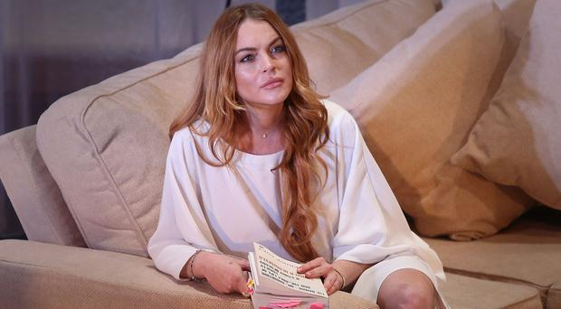Lindsay Lohan performs a scene from the play Speed the Plow (Invision/AP)
