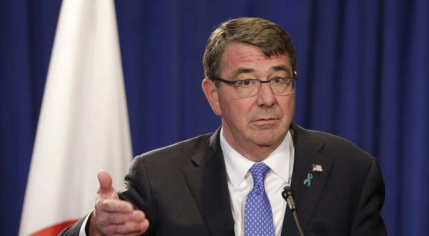 Ash Carter said turning underwater land into airfields will not expand China's sovereignty (AP)