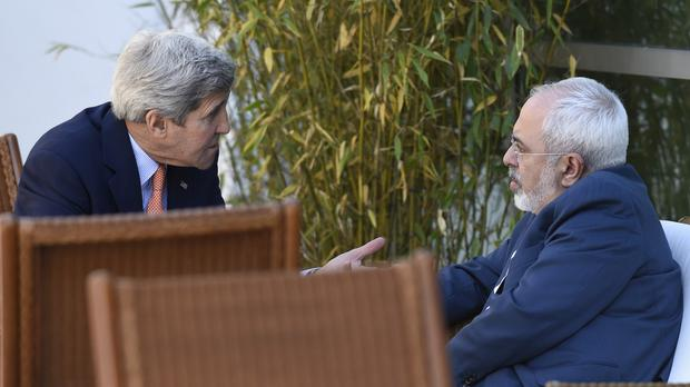 John Kerry, left, talks with Iranian foreign minister Mohammad Javad Zarif, in Geneva (AP)