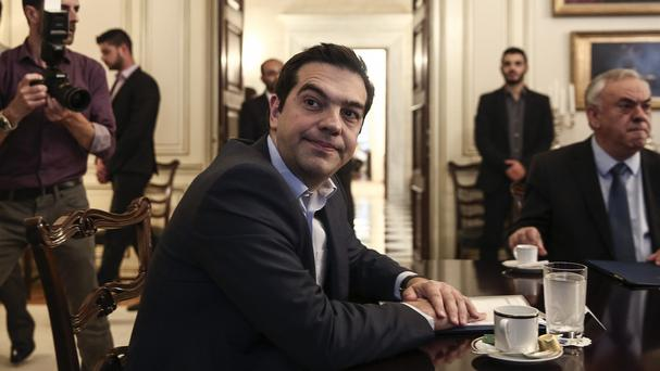 Alexis Tsipras spoke by phone to Francois Hollande and Angela Merkel