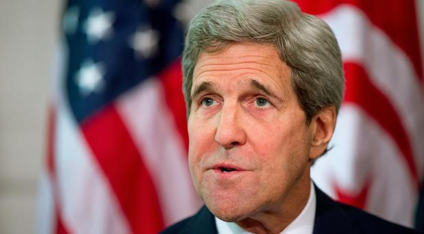 John Kerry plans to return to the United States after breaking his leg in a bike crash (AP)