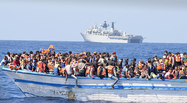 Migrants crammed into a heavily overcrowded wooden boat off the coast of Libya