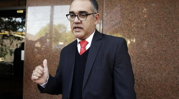 Judge Humberto Otazu speaks to journalists outside Migone Hospital, after meeting Nicolas Leoz (AP)