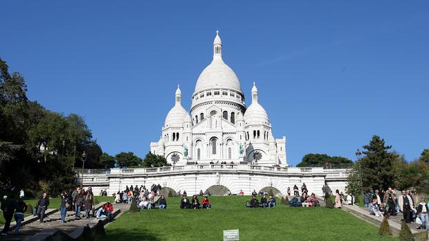 The migrants had camped in the shadow of the Sacre Coeur in Paris