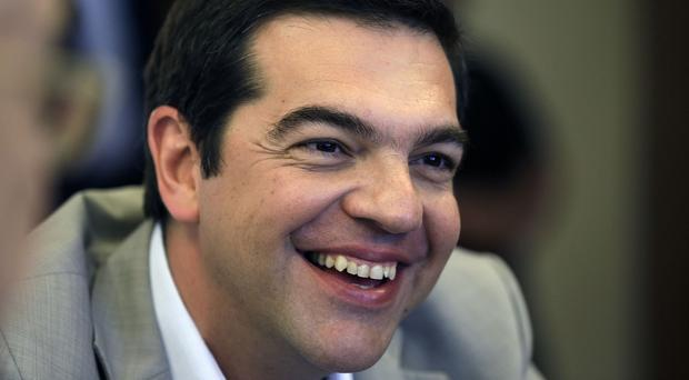 Greece's Prime Minister Alexis Tsipras said his country had submitted a proposal for an agreement with its creditors (AP)