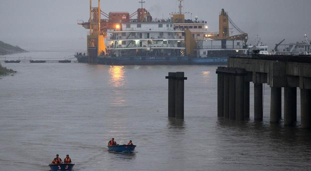 Soldiers return on boats after their search and rescue operation near a capsized cruise ship on the Yangtze River in central China's Hubei province (AP)