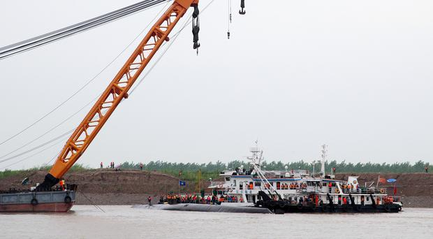Rescuers conduct search and rescue operations near the capsized ship on the Yangtze River in central China's Hubei province (AP)