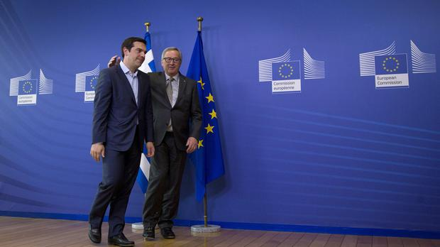 Greek prime minister Alex Tsipras and European Commission president Jean-Claude Juncker meet in Brussels (AP)