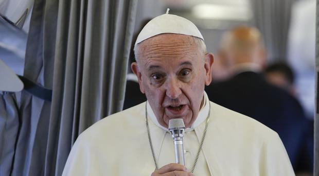 Pope Frances talks to the media on board of an airplane on his way to Sarajevo, Bosnia, for a one-day visit (AP)