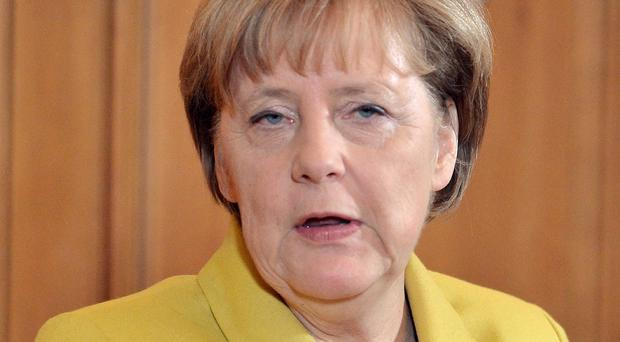 Angela Merkel is urging the G7 to honour its commitment to a climate change fund for poorer countries