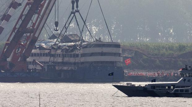 Medical workers prepare to get into the capsized Eastern Star ship after being lifted by cranes on the Yangtze River (AP)