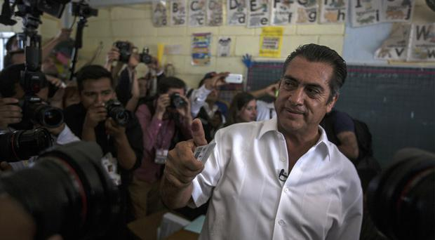 Jaime Rodriguez, known as El Bronco, shows his inked finger after casting his vote in Villa de Garcia, Mexico (AP)