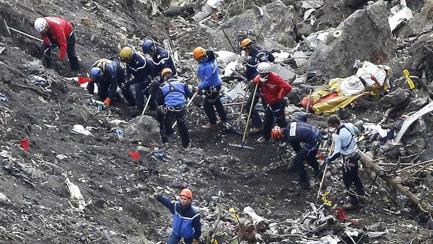 Experts comb the debris of the Germanwings jet at the crash site near Seyne-les-Alpes, France. (AP)
