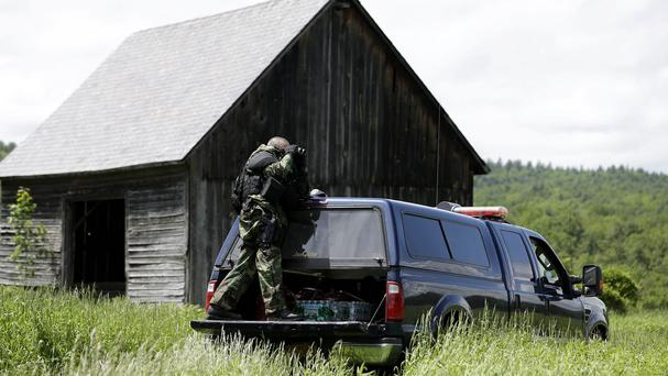 Police search for two escaped killers in New York state. (AP)