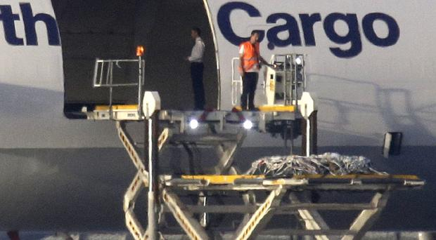 Coffins of the victims of the Germanwings crash arrived back in Dusseldorf, Germany, yesterday (AP)