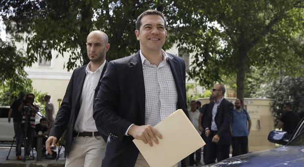 Greece's Prime Minister Alexis Tsipras is set to meet Angela Merkel. (AP)