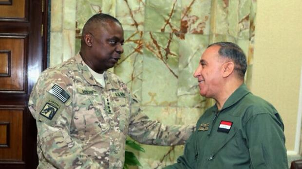 US Army General Lloyd Austin meets Iraq's defence minister Khaled al-Obeidi in Baghdad. (AP)