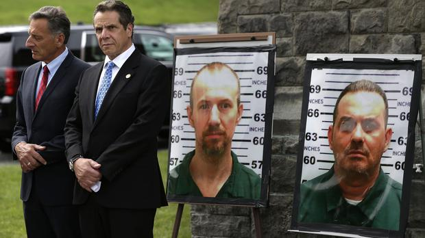 Vermont governor Peter Shumlin, left, and New York governor Andrew Cuomo at a news conference on the missing prisoners (AP)