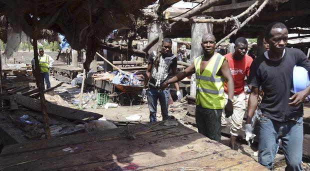Rescue workers at the site of a Boko Haram bomb attack at a market in Maiduguri, Nigeria. (AP)