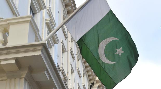 Pakistani officials on Thursday placed a lock on the gate of the group's offices