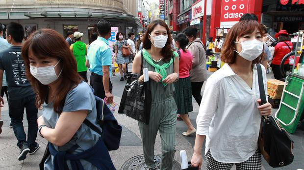 Women wear masks as a precaution against Middle East respiratory syndrome in Seoul. (AP)
