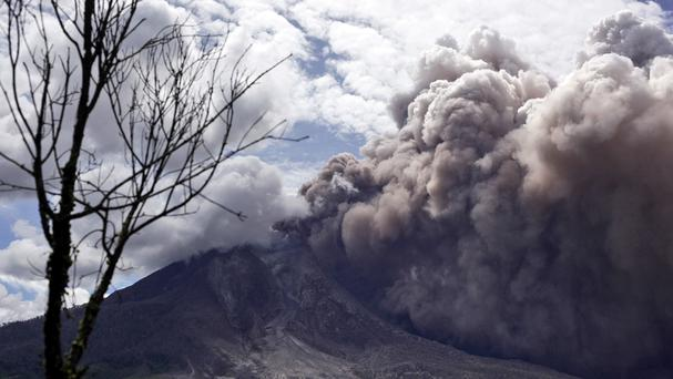 Mount Sinabung releases pyroclastic flows as seen from Tiga Pancur, North Sumatra, Indonesia. (AP)