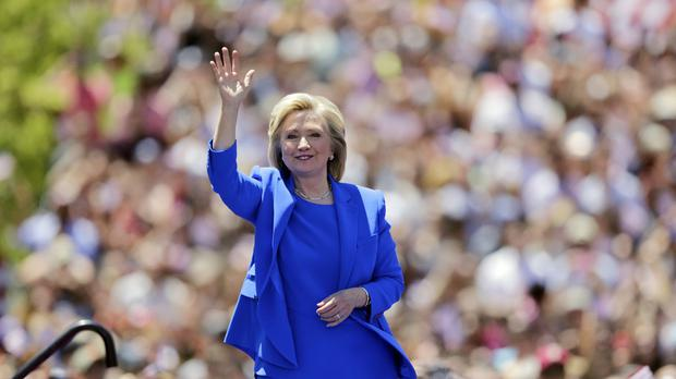 Hillary Clinton waves to supporters on Roosevelt Island in New York (AP)