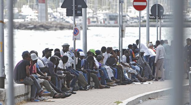 The migrants, mostly from Sudan and Eritrea, have been camped out for five days after French border police refused to let them cross (AP)