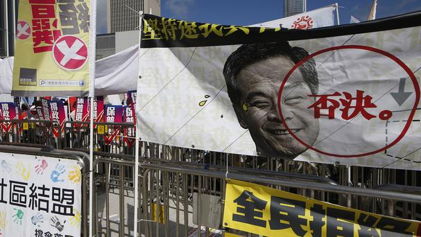 A banner depicting picture of Hong Kong chief executive Leung Chun-ying with the word