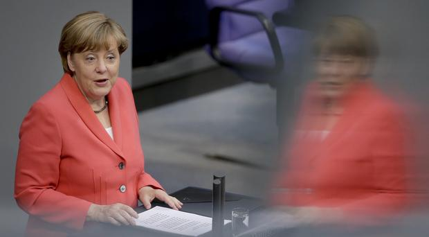 German Chancellor Angela Merkel delivers a speech pressing Greece to deliver on commitments to carry out reforms. (AP)