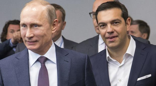 Vladimir Putin, left, and Greek prime minister Alexis Tsipras held talks at the St Petersburg International Investment Forum (AP)