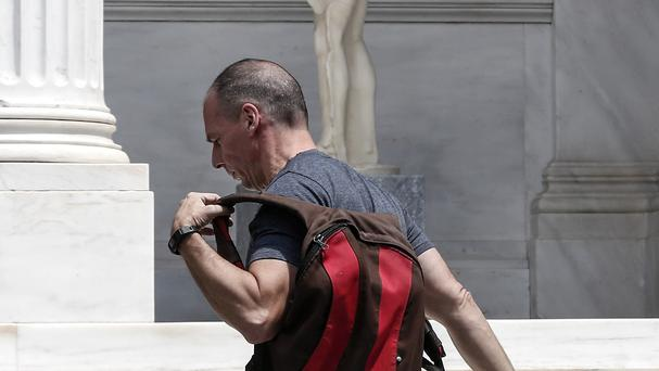 Finance Minister Yanis Varoufakis arrives for fresh talks with colleagues in Athens (AP)