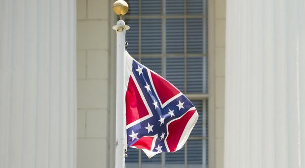 A Confederate flag flies on the grounds of the Alabama Capitol building in Montgomery, Alabama (AP/The Montgomery Advertiser)