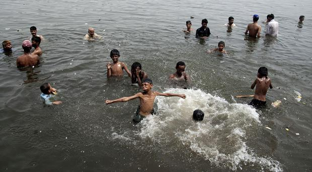 People cool off during a heatwave in Karachi, Pakistan (AP Photo/Shakil Adil)
