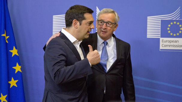 Greek Prime Minister Alexis Tsipras speaks with European Commission President Jean-Claude Juncker. (AP)