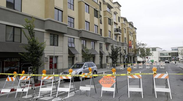 Police tape blocks off a section of Kittredge Street in front of the apartment building where a balcony collapsed in Berkeley, California (AP)