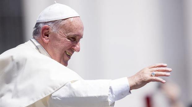 Pope Francis waves to the faithful in St Peter's Square at the Vatican (AP)