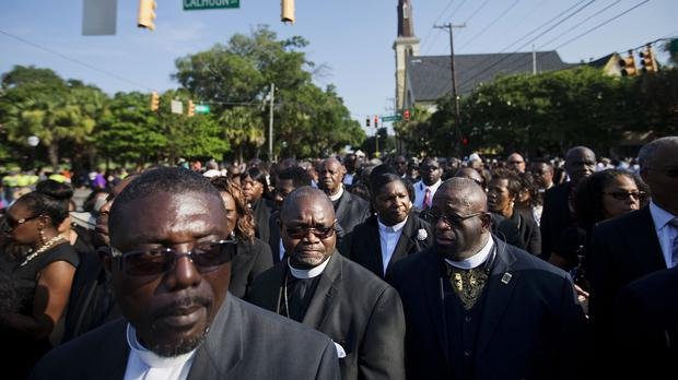 Clergy members wait to enter the funeral service for Rev Clementa Pinckney. (AP)