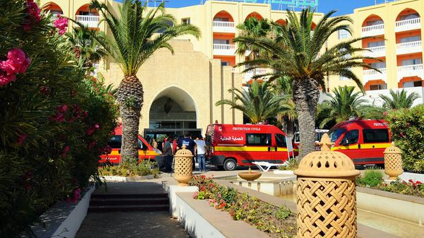 Emergency vehicles at the scene after the massacre in Sousse (AP)