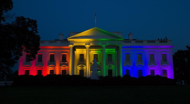 The White House is illuminated in celebration after the Supreme Court ruled that the US constitution guarantees a right to same-sex marriage (AP)