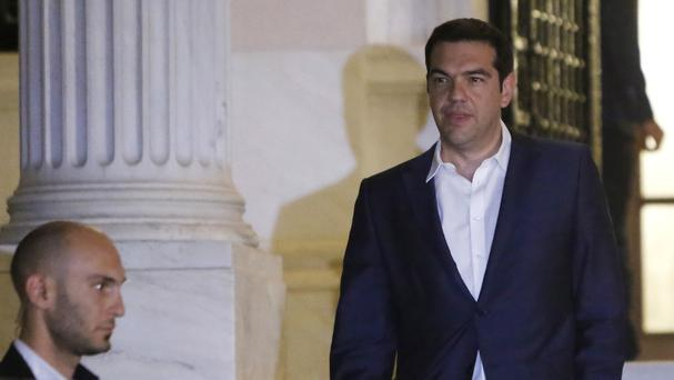 Greek prime minister Alexis Tsipras leaves the Maximos Mansion after he announced the bailout referendum (AP)