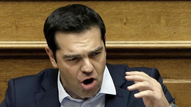 Alexis Tsipras delivers a speech during an emergency parliament session in Athens (AP)