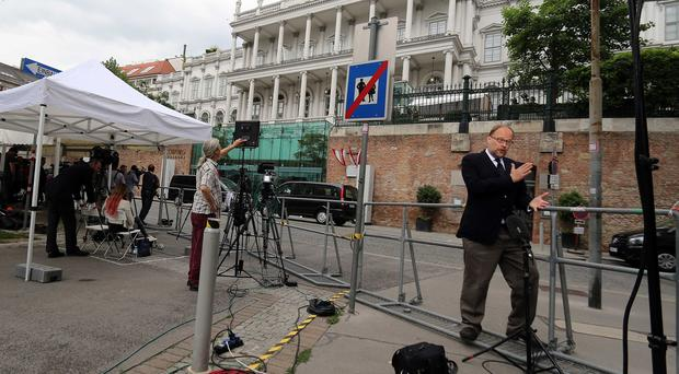 Journalists wait in front of Palais Coburg where closed-door nuclear talks with Iran take place in Vienna (AP)